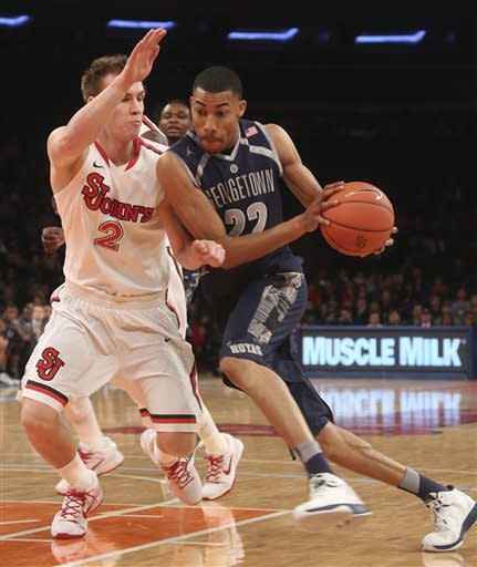 Georgetown's Otto Porter (22) drives against St. John's Phil Greene IV during the first half of an NCAA college basketball game, Saturday, Jan. 12, 2013, at Madison Square Garden in New York. Georgetown won 67-51. (AP Photo/Mary Altaffer)