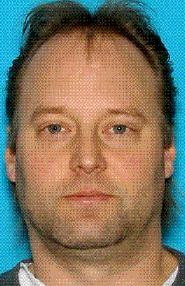 """This undated handout photo provided Monday, April 23, 2012, by the King County Sheriff's Office shows Peter A. Keller. Detectives are still trying to find Keller, 41, who lives in the house where two women were found shot to death Sunday. Keller is considered a """"person of interest"""" and has not been named as a suspect, said Sgt. Cindi West. He has been unaccounted for since the Sunday morning fire at the house that he shared with his wife and daughter. (AP Photo/King County Sheriff's Office)"""
