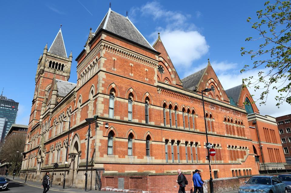People visit City Police Courts in Manchester, UK. The old landmark is a Grade II listed building.