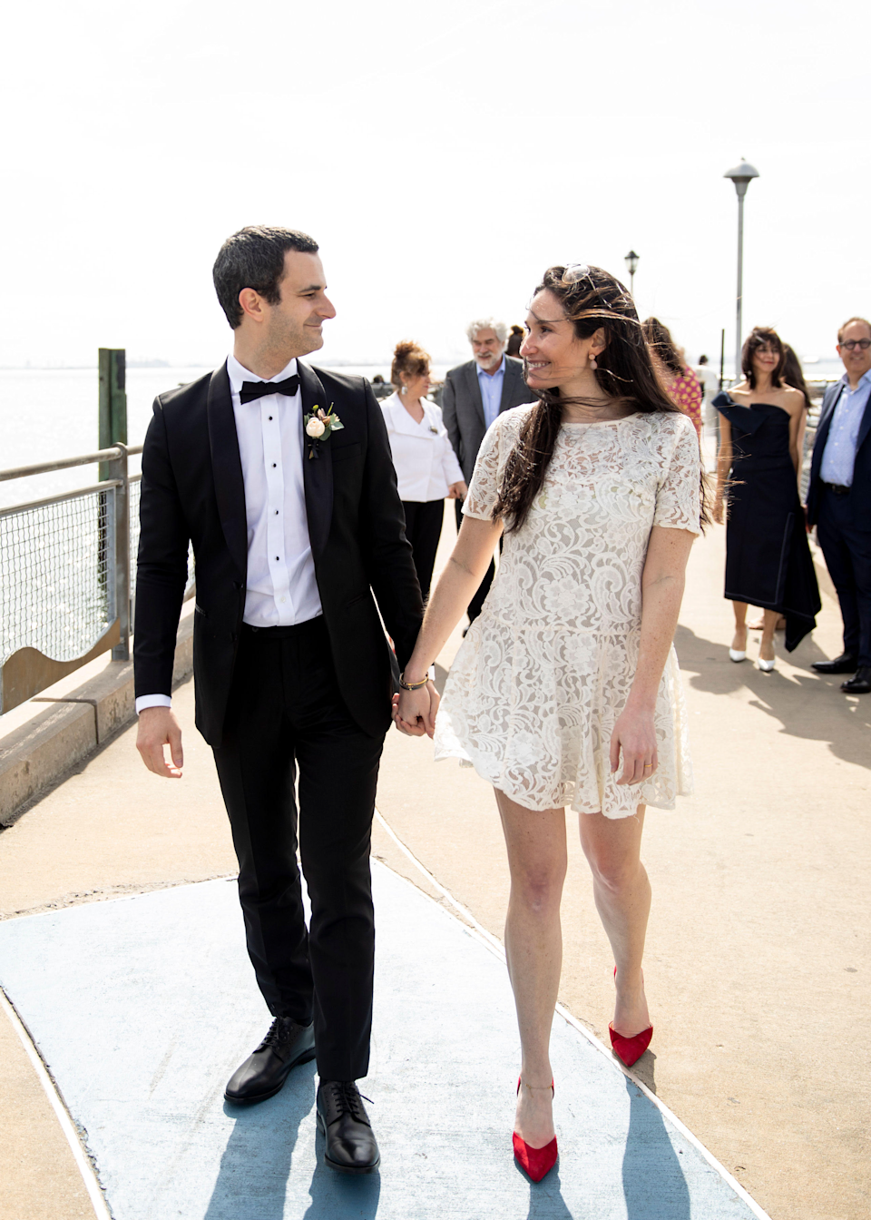"""<strong>Clarke Rosenthal, New York, New York</strong><br><strong><br></strong>""""This came together pretty last-minute once we postponed our bigger ceremony to 2021. Stores still weren't open in NYC, and with delivery dates still so unpredictable at that time, I took a long look at my own closet. I found a number of white dresses in there, many of which I've worn way too many times over the years. This one, which I've had since high school, jumped out at me as such a wearable easy option — no zippers! — and a total 180 from what I planned on wearing for my 'big' wedding. (For that, I'm wearing a Romona Keveza gown.) There was something so perfect about wearing a dress I've had for so many years for our small ceremony in my childhood backyard."""""""