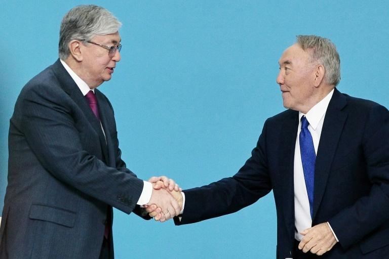 Former president Nursultan Nazarbayev (R) retains powerful positions in the ex-Soviet nation