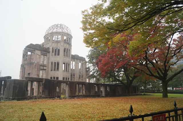 <p>The Hiroshima Peace Memorial, or Genbaku Dome, has been preserved in the same state it was in immediately after the atomic bomb was dropped on Aug. 6, 1945. It is seen here as leaves begin to take on autumn colors, on Nov. 8, 2017. (Photo: Michael Walsh/Yahoo News) </p>