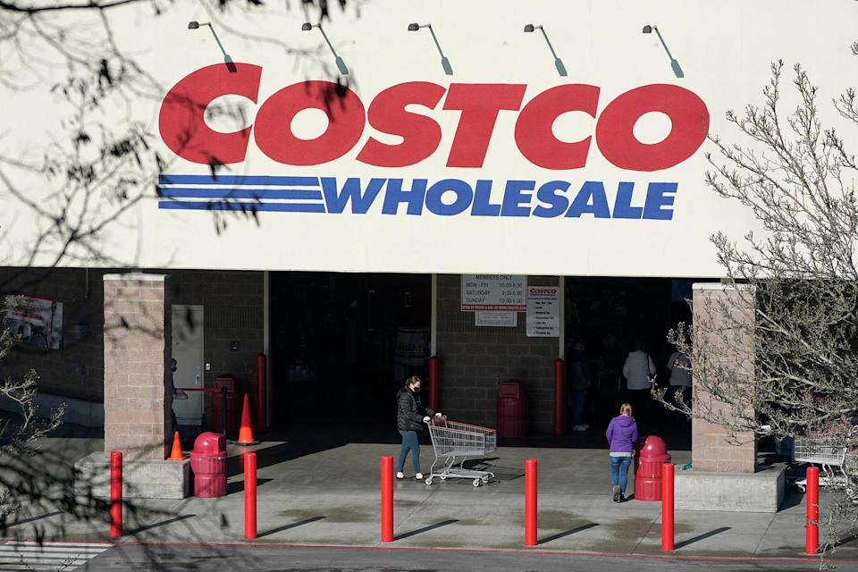 Shoppers walk into a Costco store, Wednesday, March 3, 2021, in Tacoma, Wash.