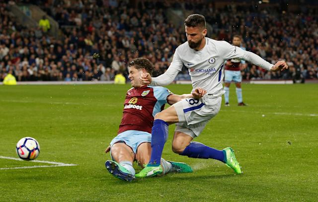 "Soccer Football - Premier League - Burnley vs Chelsea - Turf Moor, Burnley, Britain - April 19, 2018 Chelsea's Olivier Giroud shoots at goal under pressure from Burnley's James Tarkowski REUTERS/Andrew Yates EDITORIAL USE ONLY. No use with unauthorized audio, video, data, fixture lists, club/league logos or ""live"" services. Online in-match use limited to 75 images, no video emulation. No use in betting, games or single club/league/player publications. Please contact your account representative for further details."