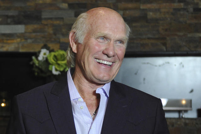 FILE - In this April 4, 2012, file photo, Hall of Fame quarterback Terry Bradshaw smiles in Nashville, Tenn. From a sackmaster defensive tackle to a do-everything running back, the list of the NFLs greatest characters, numbers 31-100, is impressive. (AP Photo/Joe Howell, File)