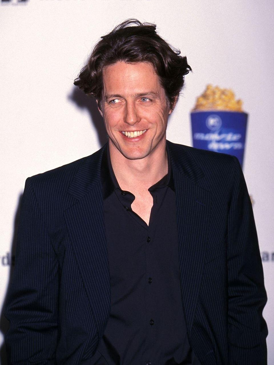 <p>Hugh Grant's floppy brown hair was one of his trademark features during his run as the go-to romantic comedy star in the 1990s.</p>