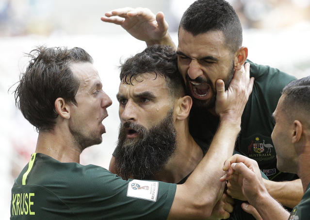 Australia's Mile Jedinak, centre, celebrates with teammates after scoring his side's opening goal during the group C match between Denmark and Australia at the 2018 soccer World Cup in the Samara Arena in Samara, Russia, Thursday, June 21, 2018. (AP Photo/Gregorio Borgia)