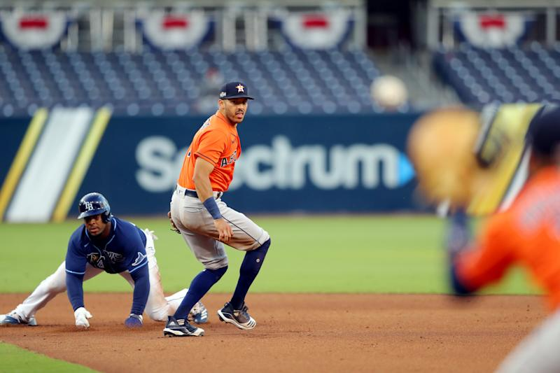 SAN DIEGO, CA - OCTOBER 16: Carlos Correa #1 of the Houston Astros turns a double play as Yandy Díaz #2 of the Tampa Bay Rays slides into second base during Game 6 of the ALCS at Petco Park on Friday, October 16, 2020 in San Diego, California. (Photo by Alex Trautwig/MLB Photos via Getty Images)