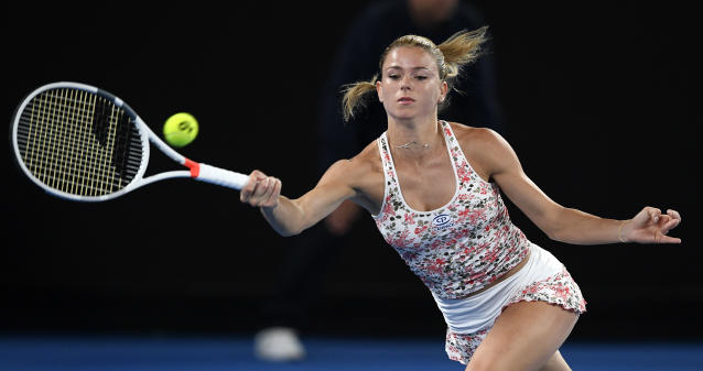 Italy's Camila Giorgi makes a forehand return to Karolina Pliskova of the Czech Republic during their third round match at the Australian Open tennis championships in Melbourne, Australia, Saturday, Jan. 19, 2019. (AP Photo/Andy Brownbill)