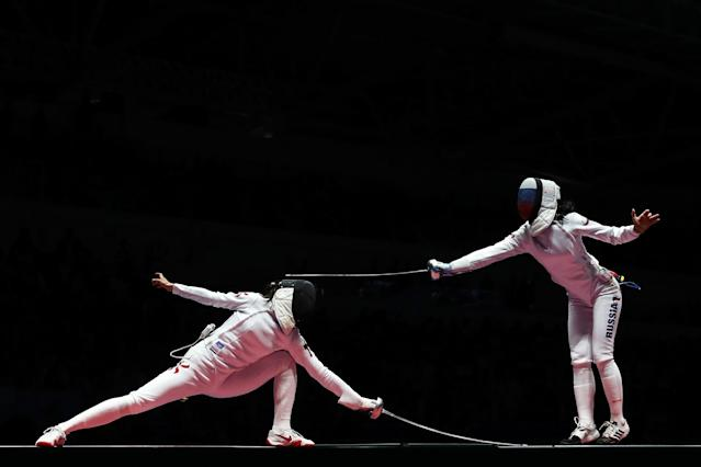 <p>Lyubov Shutova of Russia (R) in action against Man Wai Vivian Kong (L) of China during the Women's Individual Epee: round of 32 on Day 1 of the Rio 2016 Olympic Games at Carioca Arena 3 on August 6, 2016 in Rio de Janeiro, Brazil. (Photo by Ryan Pierse/Getty Images) </p>