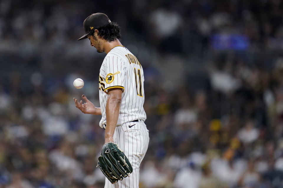 San Diego Padres starting pitcher Yu Darvish tosses the ball as he works against a Los Angeles Dodgers batter during the first inning of a baseball game Thursday, Aug. 26, 2021, in San Diego. (AP Photo/Gregory Bull)