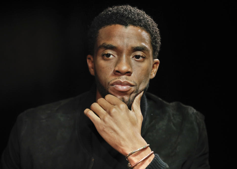 """FILE - In this Sept. 21, 2017, file photo, actor Chadwick Boseman appears at an interview for the film """"Marshall,"""" in Washington. The acclaimed actor is being posthumously honored as the namesake of Howard's newly re-established Chadwick A. Boseman College of Fine Arts. Boseman, who graduated in 2000 with a BFA in directing, died in August 2020 at age 43 of colon cancer, after an illness that was largely kept secret. He rose to prominence playing a succession of Black icons in biographical films: Jackie Robinson, singer James Brown and Thurgood Marshall. (AP Photo/Pablo Martinez Monsivais, File)"""