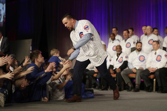 "<a class=""link rapid-noclick-resp"" href=""/mlb/players/9861/"" data-ylk=""slk:Kyle Schwarber"">Kyle Schwarber</a> works the room. He enters spring training 20 pounds lighter, eying a bounce-back season. (AP Photo/Charles Rex Arbogast)"