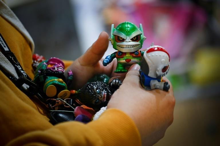 Legions of young Chinese are hooked on snaffling up the toys -- from pop art-inspired figurines to mini-archaeological treasures