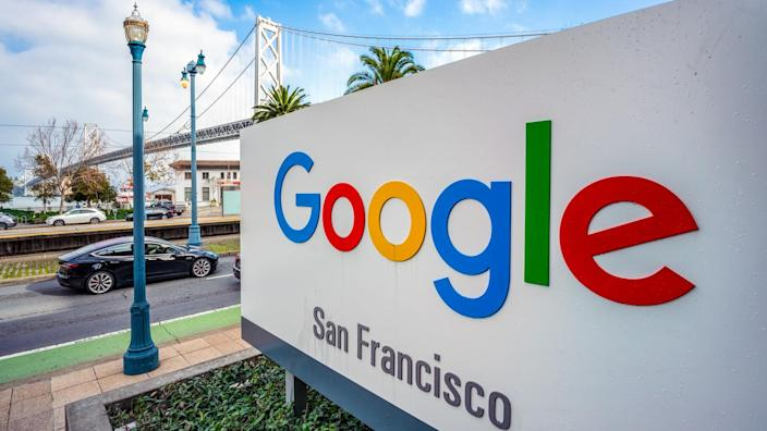 San Francisco, USA - A large sign outside Google's offices in San Francisco, with the San Francisco - Oakland Bay Bridge in the background.
