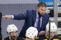 """FILE - In this April 25, 2021 file photo, Boston Bruins head coach Bruce Cassidy gives instructions during the third period of an NHL hockey game against the Pittsburgh Penguins in Pittsburgh. Cassidy said the Bruins are kind of """"playing themselves"""" in the second round against the New York Islanders because the East Division rivals have similar styles, structure and strong goaltending. (AP Photo/Gene J. Puskar, File)"""