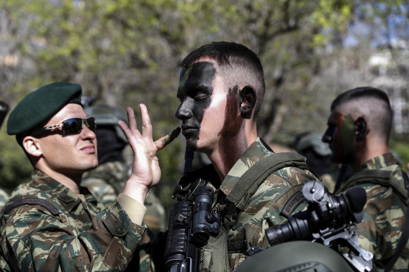 Army officers paint their faces ahead of a military parade in Athens, on Monday March 25, 2019. The parade commemorates Greek Independence Day, which marks the start of the war of independence in 1821 against the 400-year Ottoman rule. (AP Photo/Yorgos Karahalis)