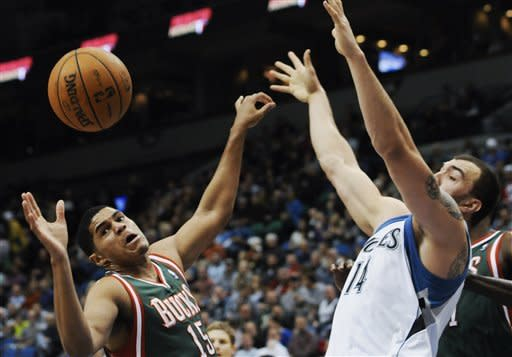 Milwaukee Bucks' Tobias Harris, left, and Minnesota Timberwolves' Nikola Pekovic, of Montenegro, eye the ball before attempting a rebound in the first half of an NBA basketball game on Friday, Nov. 30, 2012, in Minneapolis. (AP Photo/Jim Mone)