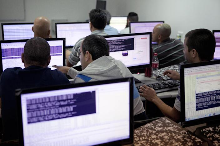 In this Tuesday Oct. 20, 2013 photo, Israelis work on computers at the 'CyberGym' school in the coastal city of Hadera. When Israel's military chief delivered a high-profile speech this month outlining the greatest threats his country will face in the future, he listed computer sabotage as a top concern, warning a sophisticated cyber attack could one day bring the nation to a standstill. (AP Photo/Dan Balilty)