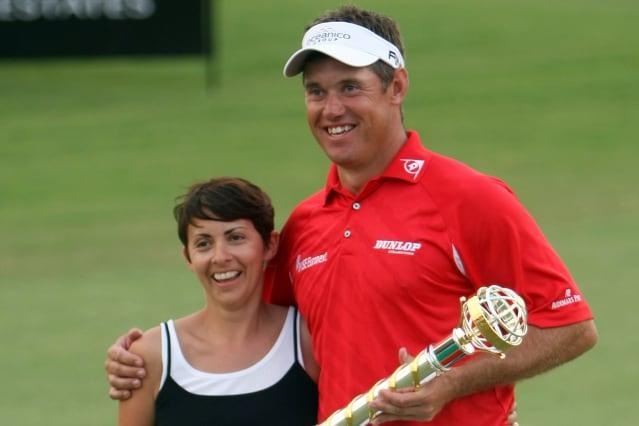 England's Lee Westwood poses with his tr