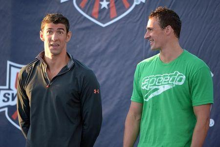 Aug 10, 2014; Irvine, CA, USA; Michael Phelps (left) and Ryan Lochte at the 2014 USA National Championships at William Woollett Jr. Aquatics Complex. Mandatory Credit: Kirby Lee-USA TODAY Sports