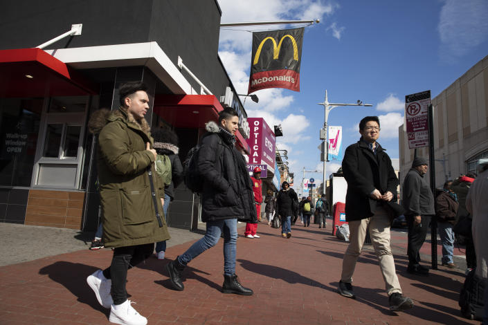 In this Feb. 28, 2020 photo, Venezuelan Kamal Morales, center, walks through his New York neighborhood. Morales' Venezuelan boyfriend, Gustavo Acosta, has spent the past year moving around U.S. immigrant detention centers in the deep south after they crossed the Mexico-U.S. border together to apply for asylum. Morales' own asylum request was rejected and he was ordered deported, but is currently living in New York while on parole. (AP Photo/Mark Lennihan)