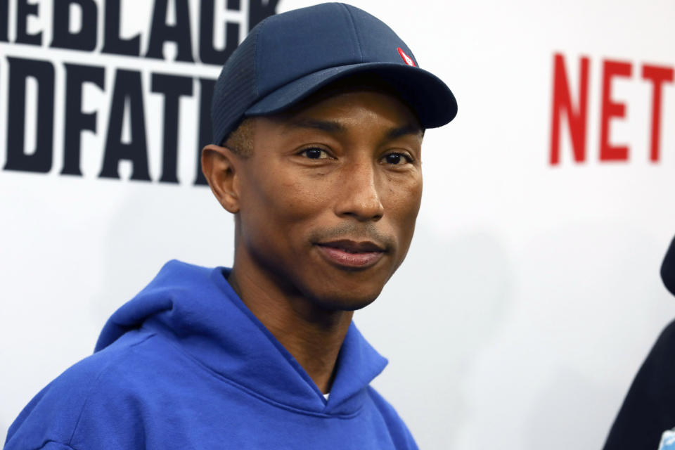 "FILE - Pharrell Williams attends the world premiere of ""The Black Godfather,"" in Los Angeles on June 3, 2019. Dozens of artists have objected to Donald Trump using their music in his two presidential campaigns. Williams sent a cease-and-desist letter after his song ""Happy"" was played at a Trump rally in 2018. He was especially angered that the event was hours after a mass shooting at a Pittsburgh synagogue. (Photo by Mark Von Holden/Invision/AP, File)"