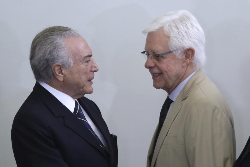 FILE - In this May 12, 2017 file photo, Brazil's President Michel Temer and Minister of Mines and Energy Moreira Franco, attend a ceremony at the Planalto Presidential Palace, in Brasilia, Brazil. A judge in Rio de Janeiro issued an arrest warrant Thursday, March 21, 2019, for the former president and Franco, who are being investigated in several corruption cases. (AP Photo/Eraldo Peres, File)