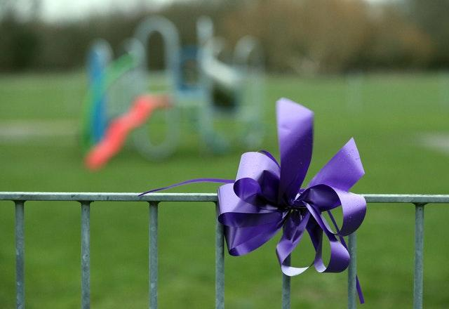 A purple bow attached to railings in St Neot's Road, Harold Hill, in memory of Jodie Chesney