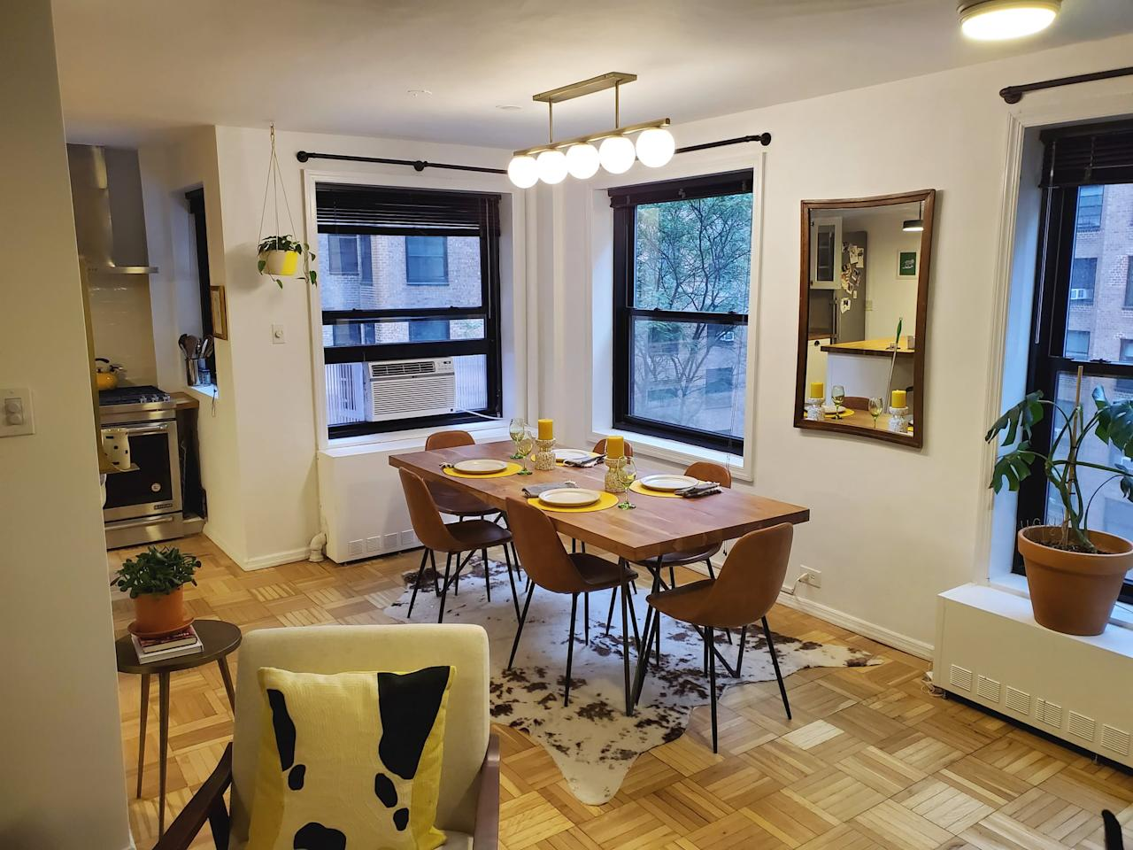 <p>This is our third apartment together and the first that was spacious enough to accommodate a dining table. We splurged on the table and lighting fixture, but all the other decor pieces were relatively affordable, including some secondhand gems (like the mirror and wine glasses).</p>
