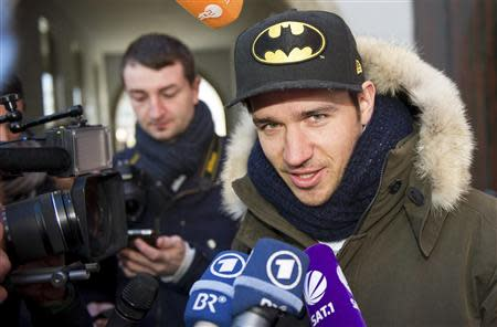 German alpine skier Felix Neureuther talks to the media after leaving a medical check with his doctor Hans-Wilhelm Mueller-Wohlfahrt in Munich February 14, 2014. REUTERS/Lukas Barth