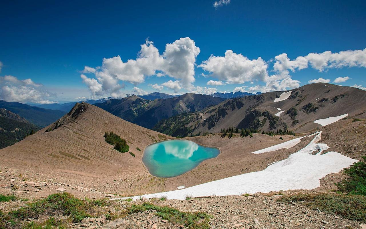 """<p>The journey to <a href=""""https://www.nps.gov/olym/planyourvisit/obstruction-point-to-deer-park.htm"""" target=""""_blank"""">Obstruction Point</a> in <a href=""""https://www.travelandleisure.com/trip-ideas/national-parks/things-to-do-campgrounds-olympic-national-park"""" target=""""_blank"""">Washington's Olympic National park</a> is part of what makes <a href=""""https://www.travelandleisure.com/trip-ideas/lake-cushman-washington"""" target=""""_blank"""">heading to the location</a> all the more appealing for Will.</p> <p>Make your way up Hurricane Ridge and you'll go along a winding scenic road where you'll see massive evergreen trees that get thinner and thinner the higher you go. Meanwhile, you'll see deer and fawns all along the way to the top, where you'll stand among the peaks of the Olympic Range.</p> <p>You'll see glaciers and get breathtaking 360-degree panoramic views of the mountain, while another dirt road will then lead you to Olympic Point, all while you encounter turnouts for different lakes along the way.</p> <p>""""Once you arrive, you're within three miles of some of the most beautiful hikes with turquoise glacial ponds, lakes, and a quiet unlike anything you'll experience,"""" Will said of the location. """"It's like you can hear all of the blood vessels in your head and it's definitely one of the most quiet places you'll step into,"""" he added. </p> <p>Watch their video of the park <a href=""""https://vimeo.com/108785446"""" target=""""_blank"""">here</a>. </p>"""