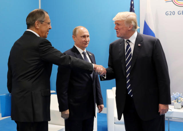 Russian Foreign Minister Sergey Lavrov, Russian President Vladimir Putin, and U.S President Trump during the G-20 summit in Hamburg, Germany, in July 2017. (Photo: Mikhail Klimentyev, Kremlin Pool Photo via AP)