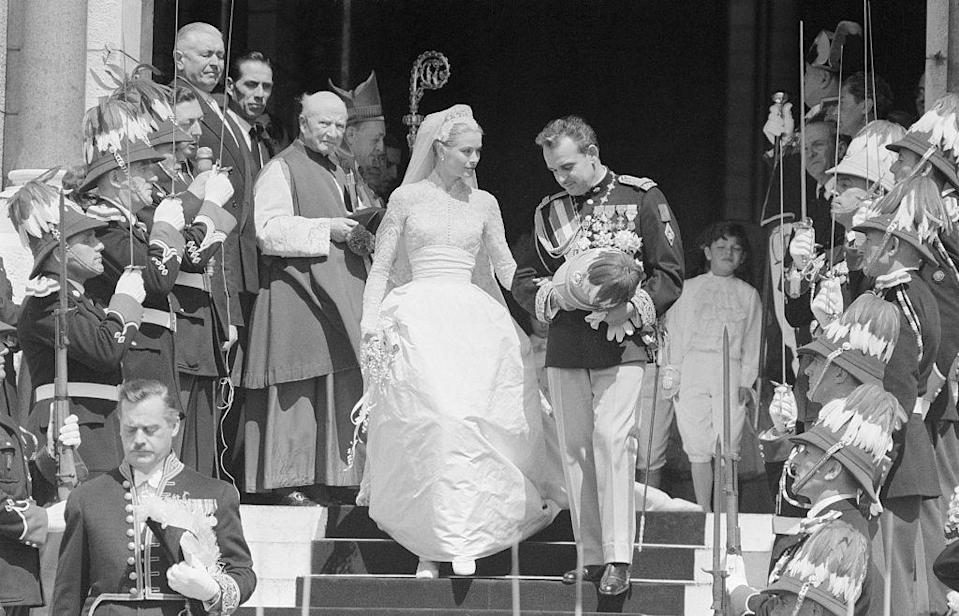 """<p>Grace Kelly and Prince Rainier of Monaco met at the 1955 Cannes Film Festival. On April 19, 1956, the Philadelphia-born actress, in a dress designed by Helen Rose, <a href=""""https://www.townandcountrymag.com/society/tradition/a12787551/grace-kelly-wedding/"""" rel=""""nofollow noopener"""" target=""""_blank"""" data-ylk=""""slk:married the prince at the Cathedral of Saint Nicholas"""" class=""""link rapid-noclick-resp"""">married the prince at the Cathedral of Saint Nicholas</a>. They had three children and remained married until she died in 1982.</p>"""
