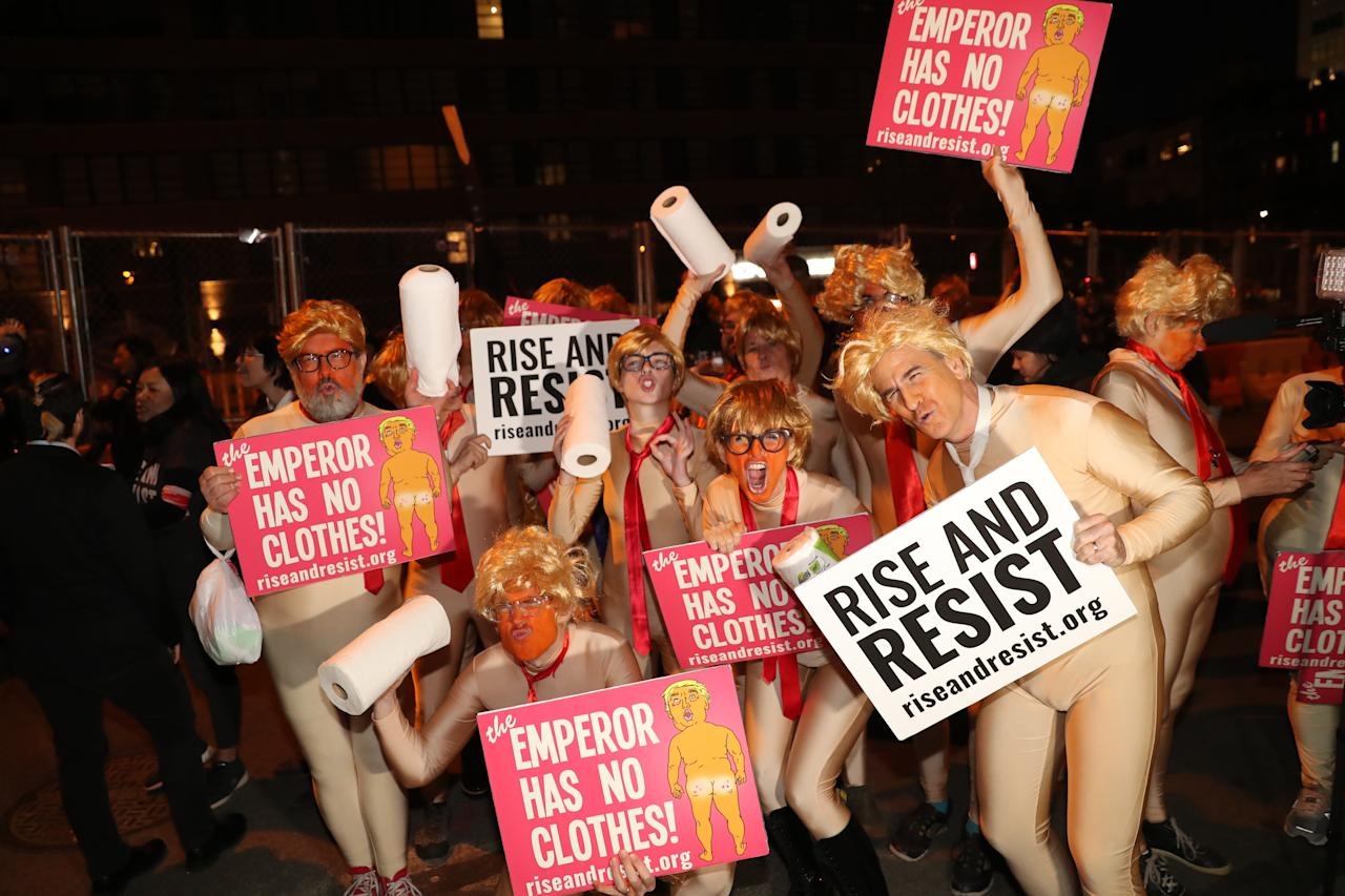 "<p>A group anti-Trump protesters from ""Rise and Resist"" pose for a photo before the Village Halloween Parade in New York City on Oct. 31, 2017. (Photo: Gordon Donovan/Yahoo News) </p>"