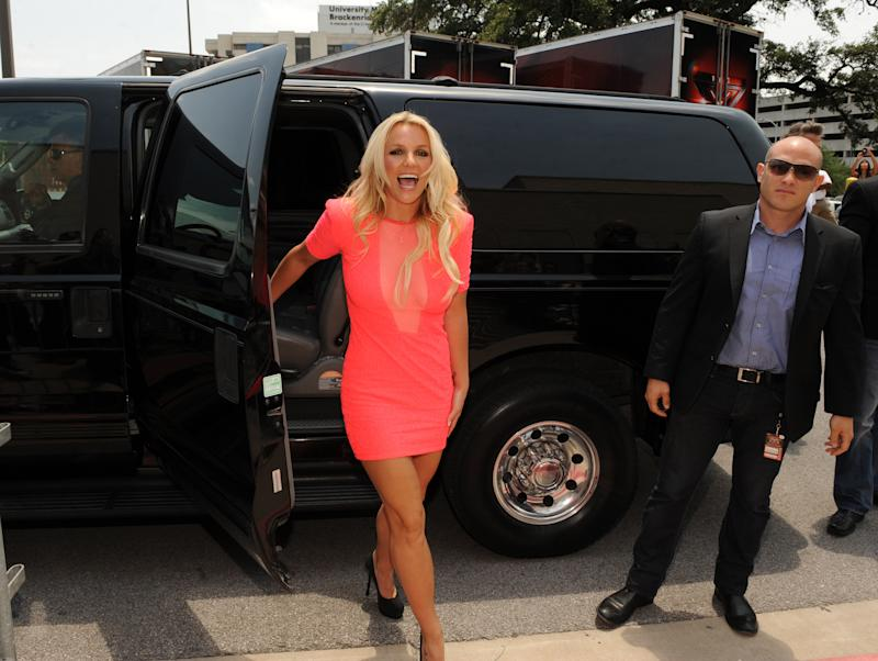 "In this Thursday, May 24, 2012 photo released by Fox, singer Britney Spears arrives at the taping of ""The X-Factor,"" in Austin, Texas. Spears will be a judge on the second season of the singing competition series. (AP Photo/Fox, Frank Micelotta)"