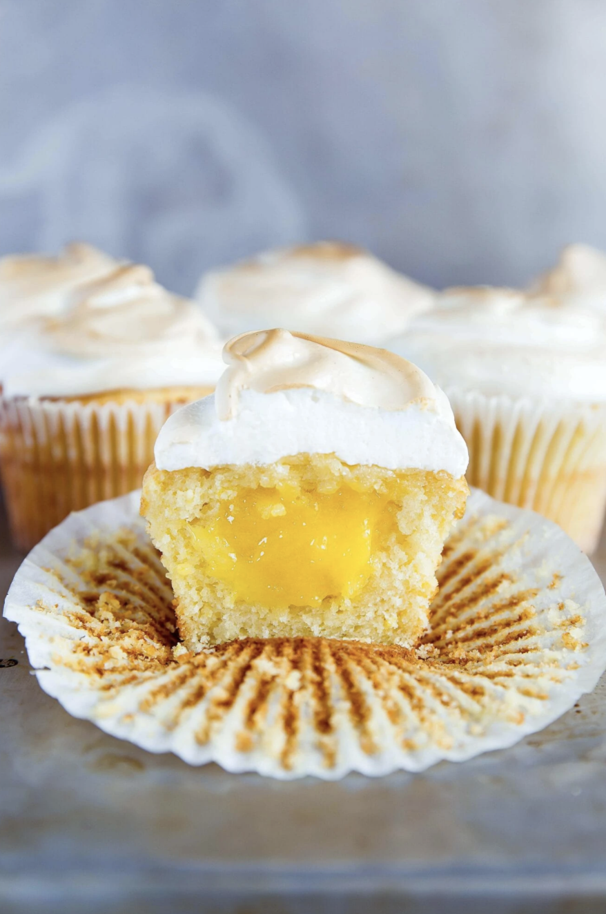 """<p>Do you and your other half love lemon meringue pie? Then these cupcakes filled with lemon curd are exactly what you need.</p><p><strong>Get the recipe at <a href=""""https://bromabakery.com/lemon-meringue-cupcakes-recipe/"""" rel=""""nofollow noopener"""" target=""""_blank"""" data-ylk=""""slk:Broma Bakery"""" class=""""link rapid-noclick-resp"""">Broma Bakery</a>.</strong></p><p><strong><a class=""""link rapid-noclick-resp"""" href=""""https://go.redirectingat.com?id=74968X1596630&url=https%3A%2F%2Fwww.walmart.com%2Fsearch%2F%3Fquery%3Dcupcake%2Bliners&sref=https%3A%2F%2Fwww.thepioneerwoman.com%2Ffood-cooking%2Fmeals-menus%2Fg35139389%2Fvalentines-day-cupcake-ideas%2F"""" rel=""""nofollow noopener"""" target=""""_blank"""" data-ylk=""""slk:SHOP CUPCAKE LINERS"""">SHOP CUPCAKE LINERS</a><br></strong></p>"""