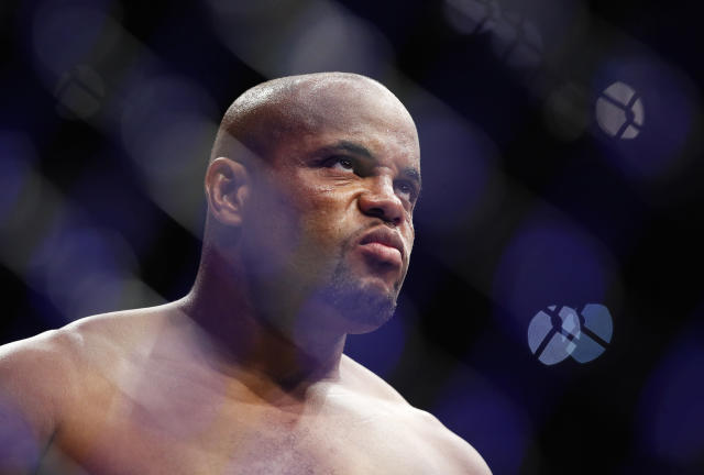 Daniel Cormier stands in the octagon before a heavyweight title mixed martial arts bout against Stipe Miocic at UFC 226, Saturday, July 7, 2018, in Las Vegas. (AP Photo/John Locher)
