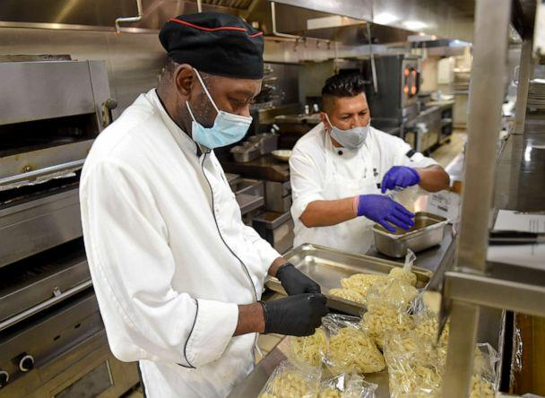 PHOTO: Executive Chef Willie Brockington, left, and line chef Saul Sibri, work in the kitchen at Stokesay Castle in Lower Alsace Township, Pa., August 6, 2020. (Medianews Group/reading Eagle Vi/MediaNews Group via Getty Images)