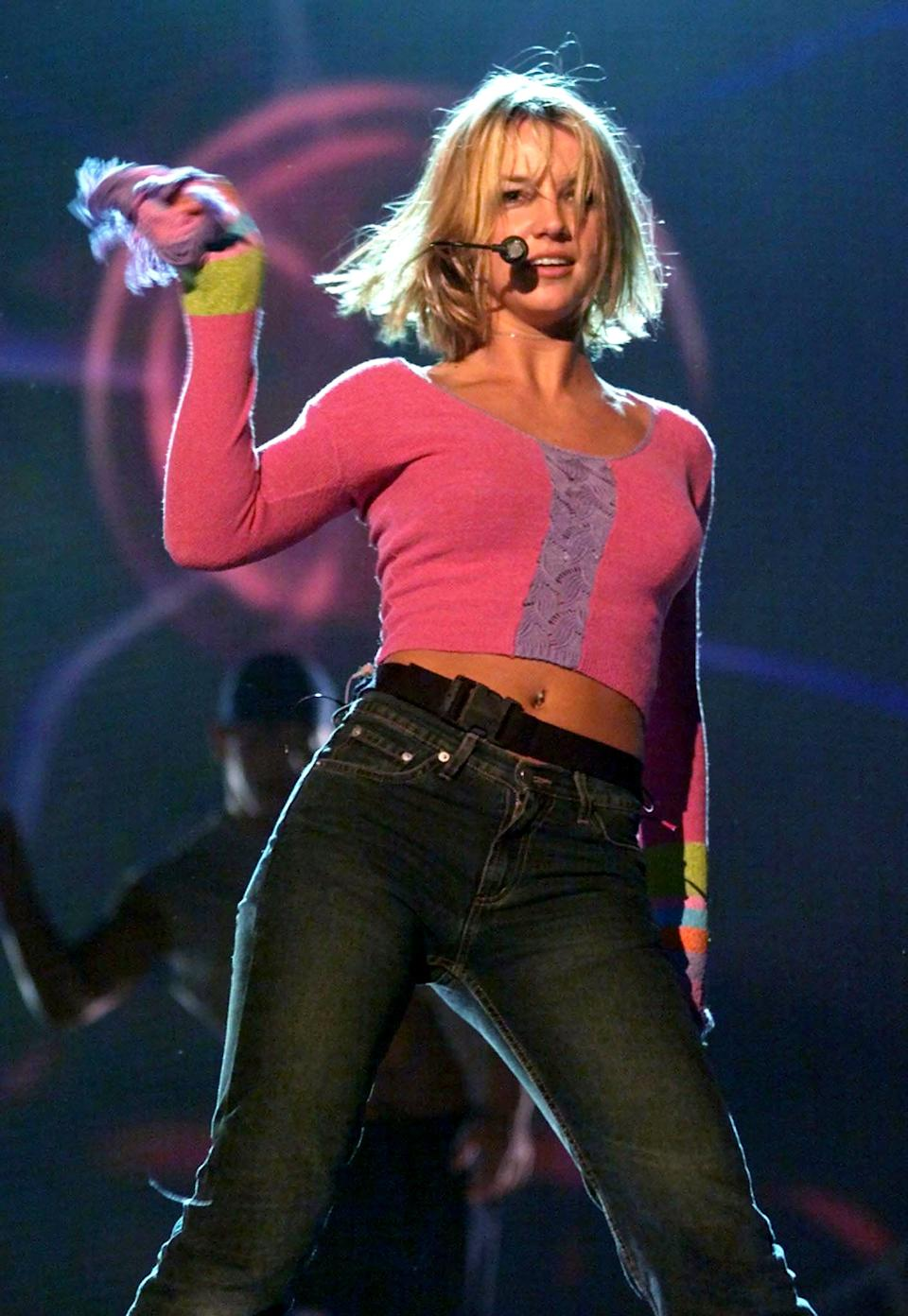 """Singer Britney Spears rehearses her song """"Baby Hit Me One More Time"""" during a rehearsal at the Staples Center, February 20 in Los Angeles. Spears will perform the song at the Grammy Awards which will be telecast from Los Angeles February 23. Spears is also nominated as Best New Artist."""