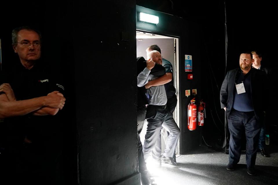 The heckler is ejected (Christopher Furlong/Getty Images)