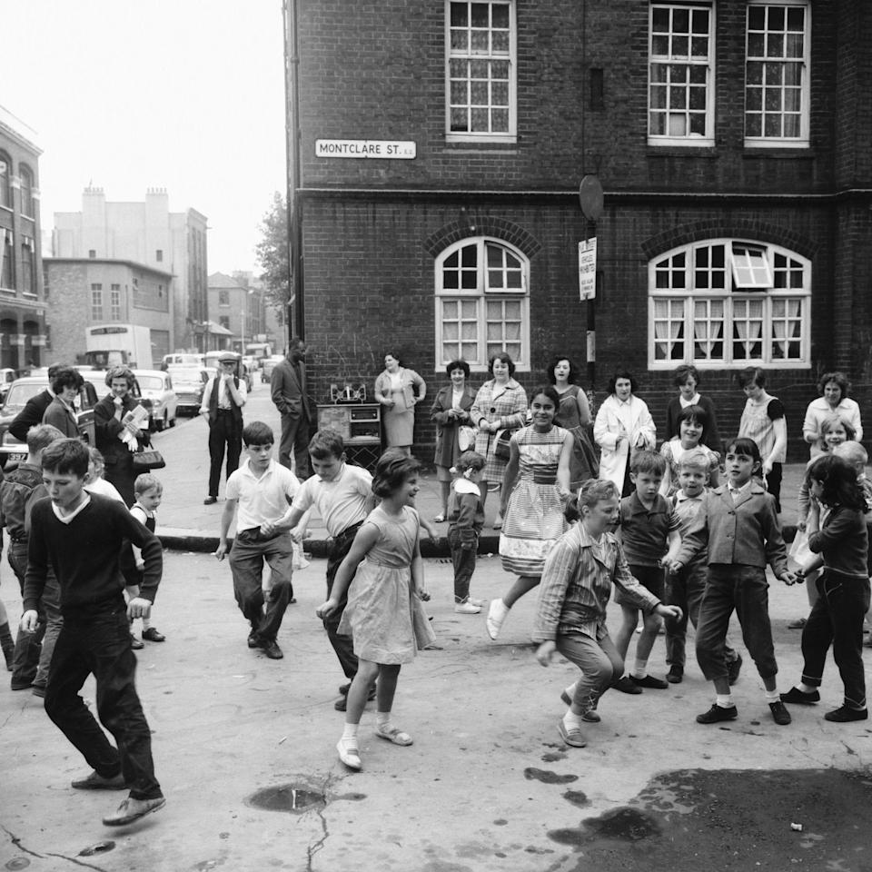 Children dance the twist in a designated play street in the East End of London. (Photo by © Hulton-Deutsch Collection/CORBIS/Corbis via Getty Images)  - Getty