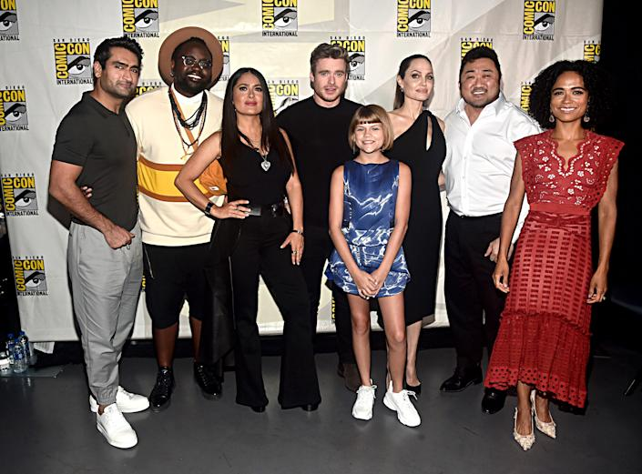 """(L-R) Kumail Nanjiani, Brian Tyree Henry, Salma Hayek, Richard Madden, Lia McHugh, Angelina Jolie, Don Lee and Lauren Ridloff of Marvel Studios' 'The Eternals' at the San Diego Comic-Con in 2019.<span class=""""copyright"""">Getty Images for Disney</span>"""