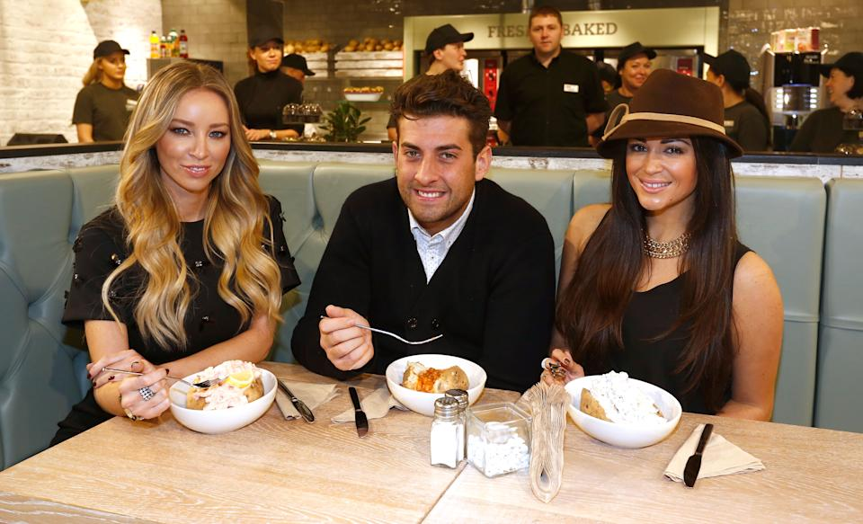 THURROCK, ENGLAND - NOVEMBER 22: Casy Batchelor with Lauren Pope and James Argent from 'The Only Way Is Essex' help cut the ribbon at the Spudulike opening at Lakeside Shopping Centre on November 22, 2014 in Thurrock, England. (Photo by Tim P. Whitby/Getty Images for Spudulike)