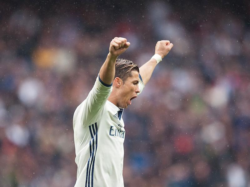 Ronaldo celebrates scoring against Valencia at the weekend: Getty