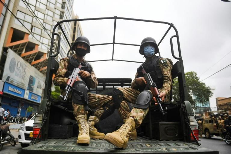 Paramilitary soldiers patrol near the Pakistan Stock Exchange building in Karachi following the attack