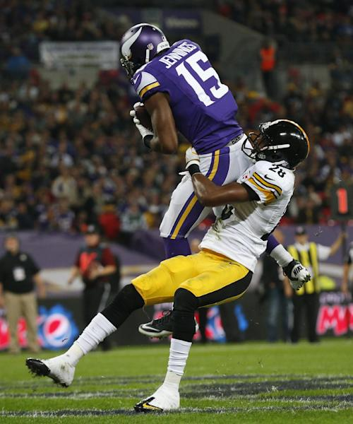Minnesota Vikings wide receiver Greg Jennings (15) is tackled by Pittsburgh Steelers cornerback Cortez Allen (28) as he pulls down a 16-yard touchdown pass to score during the second half of their NFL football game at Wembley Stadium, London, Sunday,Sept. 29, 2013. (AP Photo/Matt Dunham)