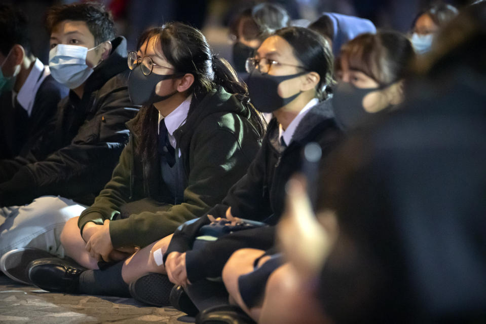 <p>Protesters gather during a rally for secondary school students near the Hong Kong Museum of Art in Hong Kong, Friday, Dec. 13, 2019. Protesters in Hong Kong wrote hundreds of Christmas cards on Thursday for people jailed in the city's pro-democracy movement, promising they won't be forgotten as they face spending the festive season behind bars. (AP Photo/Mark Schiefelbein)</p>