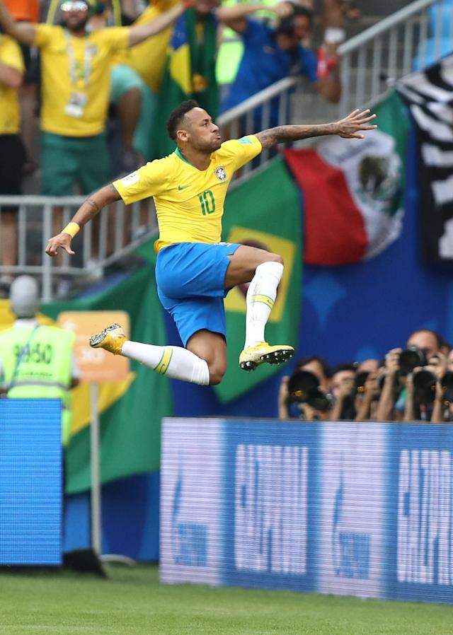 <p>Neymar Jr of Brazil celebrates after scoring his team's first goal during the 2018 FIFA World Cup Russia Round of 16 match between Brazil and Mexico at Samara Arena on July 2, 2018 in Samara, Russia. (Photo by Ryan Pierse/Getty Images) </p>