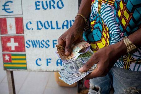Man Trades U S Dollars For Ghanaian Cedis At A Currency Exchange Office In Accra
